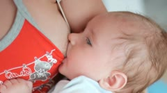 Mother feeding baby Stock Footage