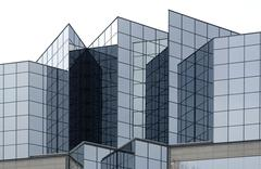 angular glass office building exterior - stock photo