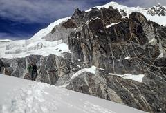 climber approaching the pass - stock photo