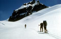 Stock Photo of telemark skiers on ascent of mt baker