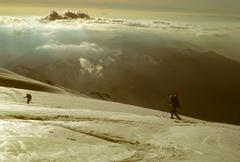 telemark skiers on ascent of mt baker - stock photo