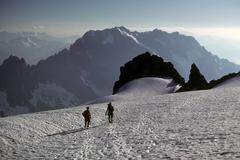 climbers descending from sahale peak - stock photo
