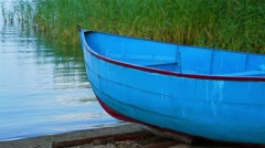 Detail of small fishing boat on lake coastline Stock Footage