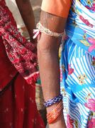 detail, indian tribal woman in saree with bangles - stock photo