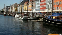Passing tour boat in Nyhavn, Copenhagen Stock Footage