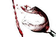 Stock Photo of fun spirts splash pour action red wine glass celebration party lifestyle happy