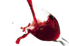 fun spirts splash pour action red wine glass celebration party lifestyle happy - stock photo