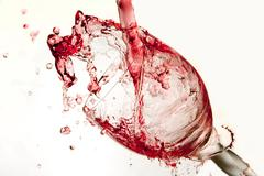 Pouring Red Wine Splashes Into A Crystal Wine Glass  Stock Photos