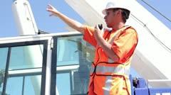 Construction worker talking on walkie talkie Stock Footage