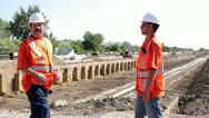 Construction workers surveying irrigation ditch Stock Footage