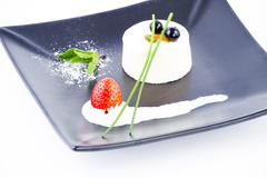 Vanilla soft and spongy mousse crowned by cranberries Stock Photos
