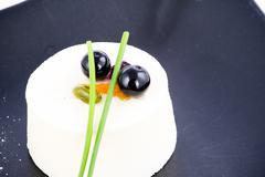 nouvelle cuisine vanilla mousse dessert with cranberries on top - stock photo
