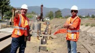 Construction workers surveying construction site Stock Footage