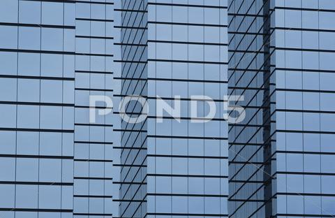 Stock photo of modern office building with glass exterior