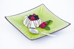 black and white chocolate with blackberries on green plate - stock photo