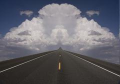 road to clouds - stock photo