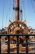 ship's helm - stock photo