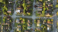 Stock Video Footage of Residential Houses from Slow Panning Overhead Aerial View