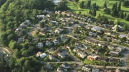 Stock Video Footage of Rich Suburban Homes on Top of Hillside - Aerial Perspective