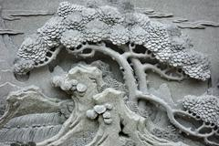 Chinese feng shui pine tree carving. Stock Photos