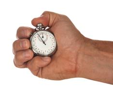 stopwatch with hand - stock photo