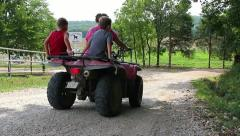 Mom and kids on four wheeler ride Stock Footage