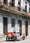 Tattered old car in a street of Central Havana, Cuba - stock photo