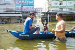 canoe in the 2011 thailand floods - stock photo