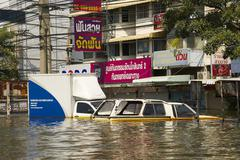 flooded vehicles in 2011 thailand floods - stock photo