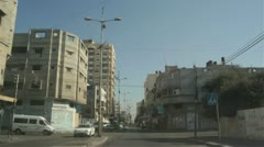 Driving along road in Gaza City Stock Footage