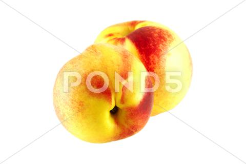 Stock photo of two juicy fresh nectarines