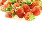 Lots of fresh strawberries over white Stock Photos