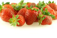 Stock Photo of lots of fresh ripe strawberries over white background