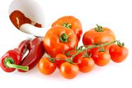 Lots of different tomatoes and red paprika Stock Photos