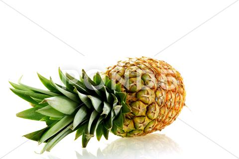 Stock photo of fresh ripe pineapple over white background