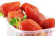 Close up of a container full of fresh strawberry Stock Photos