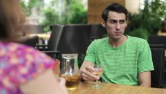Young sad man on bad date in cafe, steadicam shot HD Stock Footage