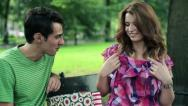 Happy couple checking their shopping bags in park, steadicam shot HD Stock Footage