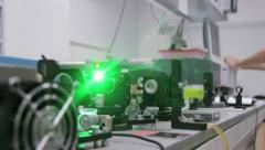 Experiments with a laser system in the laboratory 2 - stock footage