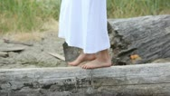 Girl's feet walking on a log Stock Footage