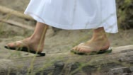 Girl's feet walking on a log Stock Footage