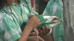Schoolchildren draw up the flag of Suriname Stock Footage