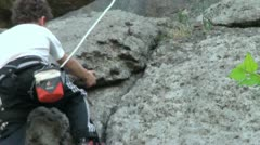 Child quickly climbs the rock Stock Footage