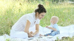 Young mother showing her glasses to the baby Stock Footage