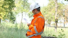 Engineer wearing safety equipment Stock Footage