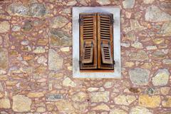 Stock Photo of wooden shutter and window