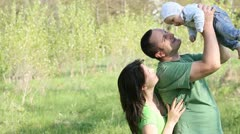 Young parents with their little baby in nature Stock Footage