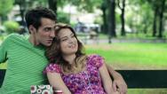 Stock Video Footage of Happy couple in love relaxing in the park, steadicam shot HD