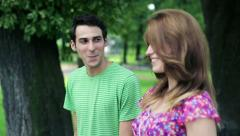 Happy couple in love walking in the park, steadicam shot HD Stock Footage