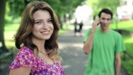 Portrait of young happy woman in the park, steadicam shot HD Stock Footage